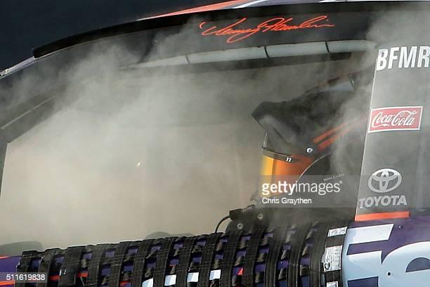 Denny Hamlin driver of the FedEx Express Toyota celebrates winning the NASCAR Sprint Cup Series DAYTONA 500 at Daytona International Speedway on...