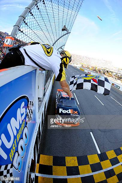 Denny Hamlin driver of the FedEx Express Toyota crosses the finish line to win the NASCAR Sprint Cup Series TUMS Fast Relief 500 at Martinsville...