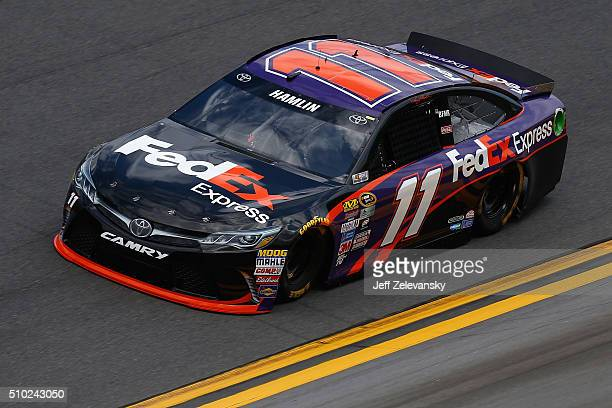 Denny Hamlin driver of the FedEx Express Toyota drives during qualifying for the NASCAR Sprint Cup Series Daytona 500 at Daytona International...