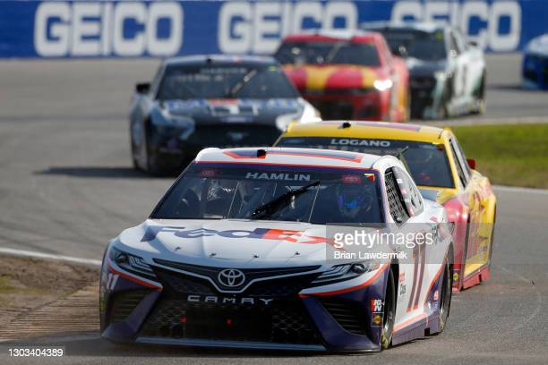 Denny Hamlin, driver of the FedEx Express Toyota, drives during the NASCAR Cup Series O'Reilly Auto Parts 253 at Daytona International Speedway on...