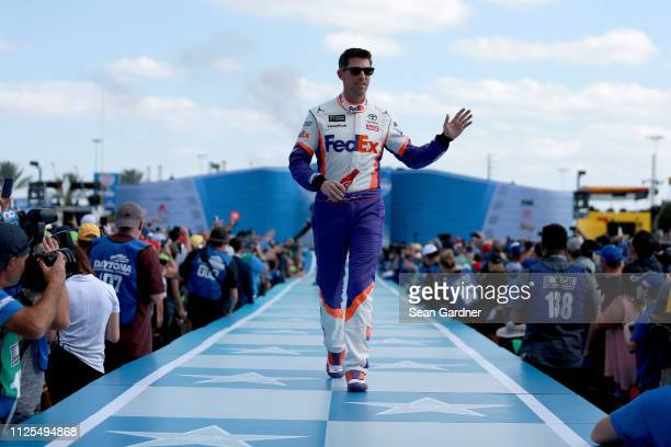 Denny Hamlin driver of the FedEx Express Toyota is introduced before the Monster Energy NASCAR Cup Series 61st Annual Daytona 500 at Daytona...
