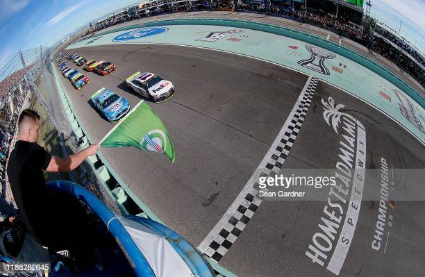 Denny Hamlin, driver of the FedEx Express Toyota, lead a pace lap prior the Monster Energy NASCAR Cup Series Ford EcoBoost 400 at Homestead Speedway...