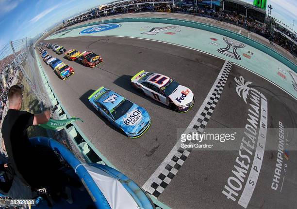 Denny Hamlin driver of the FedEx Express Toyota lead the field to the green flag to start the Monster Energy NASCAR Cup Series Ford EcoBoost 400 at...