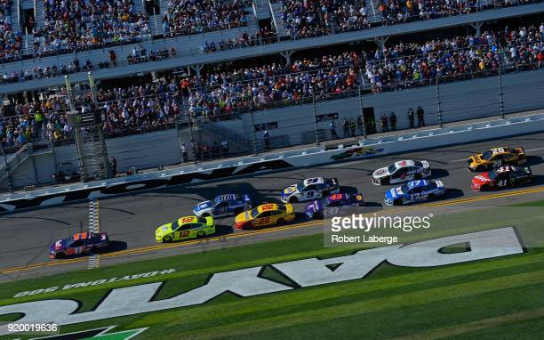 Denny Hamlin driver of the FedEx Express Toyota leads the field at the start of the Monster Energy NASCAR Cup Series 60th Annual Daytona 500 at...