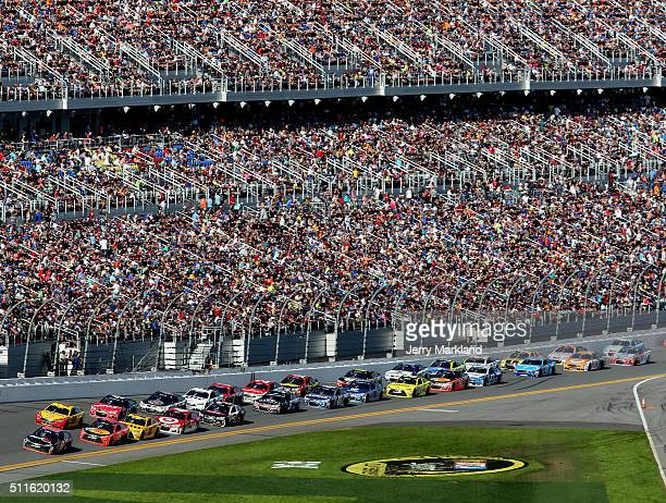 Denny Hamlin driver of the FedEx Express Toyota leads the field during the NASCAR Sprint Cup Series DAYTONA 500 at Daytona International Speedway on...