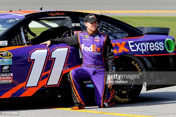 Denny Hamlin driver of the FedEx Express Toyota poses with his car after qualifying for the NASCAR Sprint Cup Series Daytona 500 at Daytona...