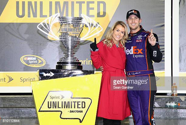 Denny Hamlin driver of the FedEx Express Toyota poses with his girlfriend Jordan Fish in Victory Lane after winning the NASCAR Sprint Cup Series...