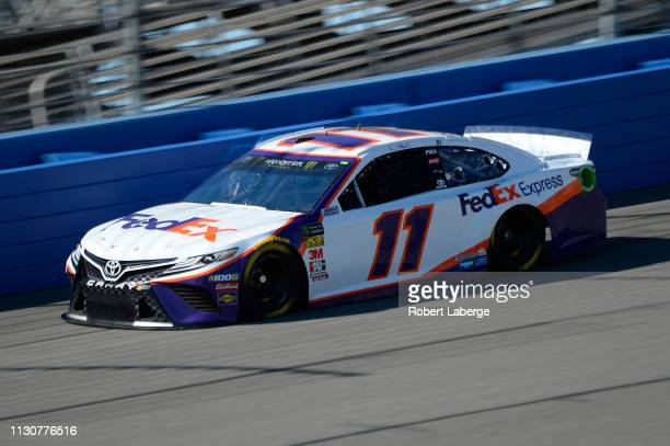 Denny Hamlin driver of the FedEx Express Toyota practices for the Monster Energy NASCAR Cup Series Auto Club 400 at Auto Club Speedway on March 15...