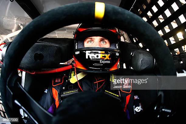Denny Hamlin driver of the FedEx Express Toyota sits in his car during practice for the NASCAR Sprint Cup Series Showtime Southern 500 at Darlington...