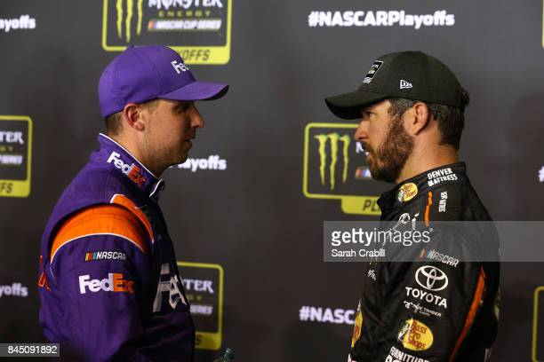 Denny Hamlin driver of the FedEx Express Toyota speaks with Martin Truex Jr driver of the AutoOwners Insurance Toyota following the Monster Energy...