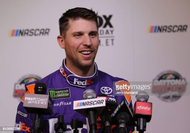 Denny Hamlin driver of the FedEx Express Toyota speaks with the media during the Daytona 500 Media Day at Daytona International Speedway on February...