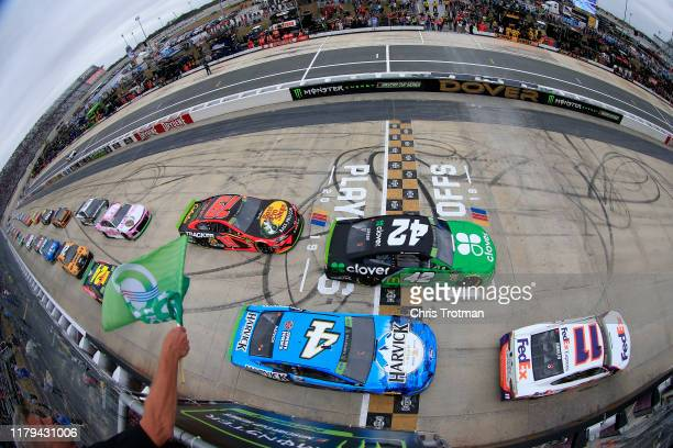 Denny Hamlin driver of the FedEx Express Toyota takes the green flag to start the Monster Energy NASCAR Cup Series Drydene 400 at Dover International...