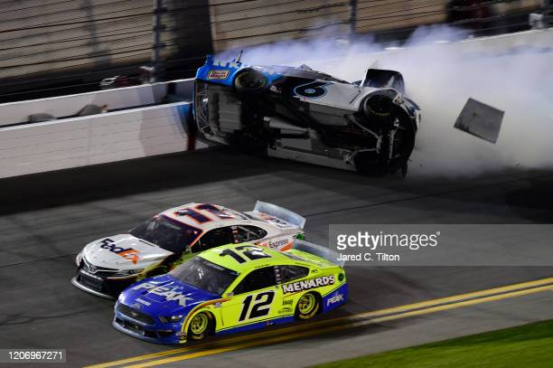 Denny Hamlin, driver of the FedEx Express Toyota, wins over Ryan Blaney, driver of the Menards/Peak Ford, as Ryan Newman, driver of the Koch...