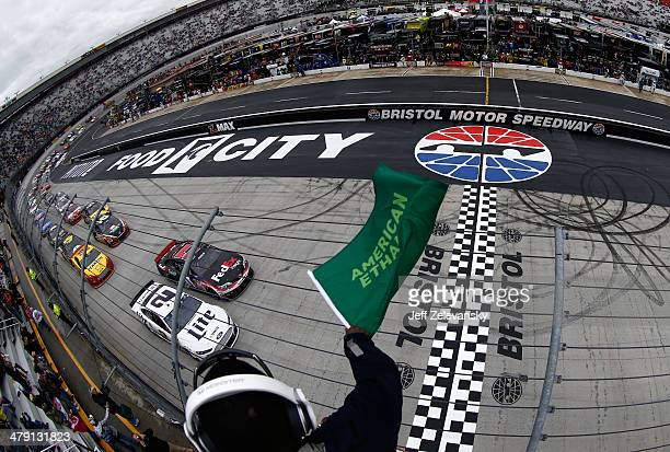 Denny Hamlin driver of the FedEx Freight Toyota and Brad Keselowski driver of the Miller Lite Ford lead the field to the green flag to start the...