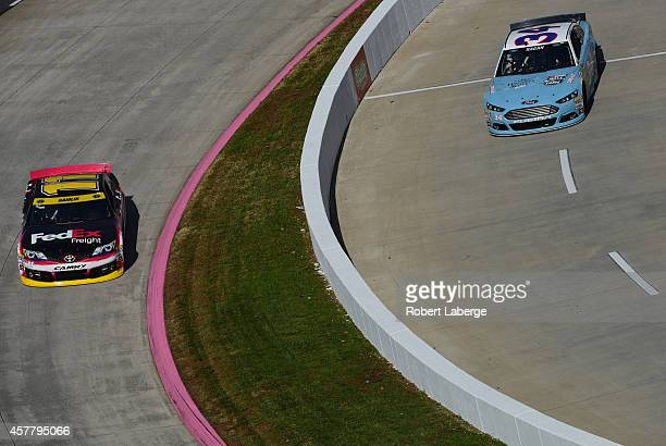 Denny Hamlin, driver of the FedEx Freight Toyota, and David Ragan, driver of the Wendell Scott Hall of Fame Tribute Ford, practice for the NASCAR...