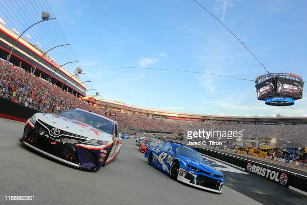 Denny Hamlin driver of the FedEx Freight Toyota and Kyle Larson driver of the Credit One Bank Chevrolet lead the field prior to the start of the...