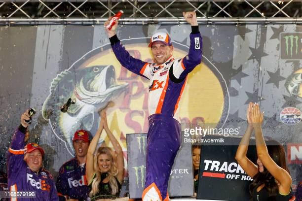 Denny Hamlin driver of the FedEx Freight Toyota celebrates in Victory Lane after winning the Monster Energy NASCAR Cup Series Bass Pro Shops NRA...