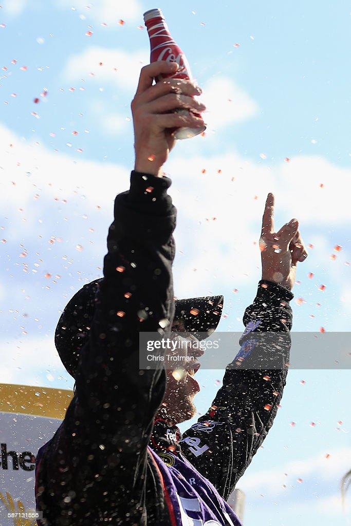 Denny Hamlin, driver of the #11 FedEx Freight Toyota, celebrates in victory lane after winning the NASCAR Sprint Cup Series Cheez-It 355 at Watkins Glen International on August 7, 2016 in Watkins Glen, New York.