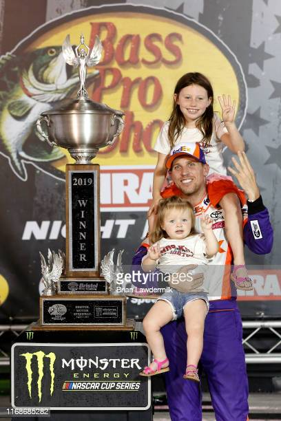 Denny Hamlin, driver of the FedEx Freight Toyota, celebrates with his daughters, Taylor and Molly, in Victory Lane after winning the Monster Energy...