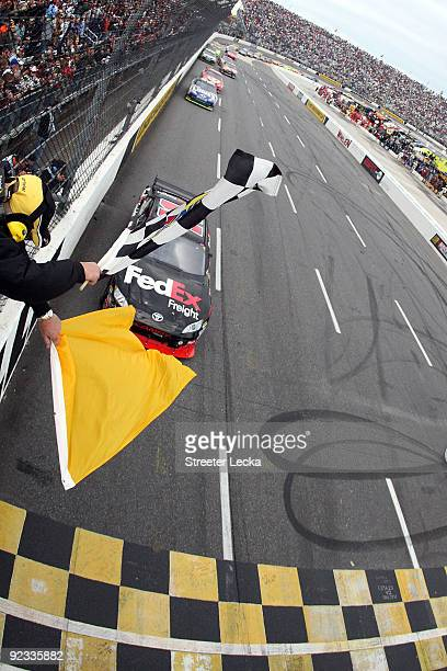 Denny Hamlin, driver of the FedEx Freight Toyota, comes to the finishline to win the NASCAR Sprint Cup Series TUMS Fast Relief 500 at Martinsville...