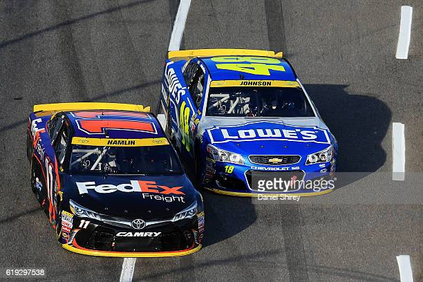 Denny Hamlin driver of the FedEx Freight Toyota leads Jimmie Johnson driver of the Lowe's Chevrolet during the NASCAR Sprint Cup Series Goody's Fast...
