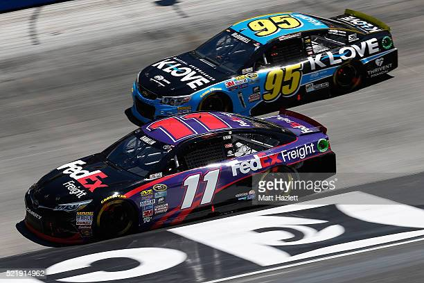 Denny Hamlin driver of the FedEx Freight Toyota races Michael McDowell driver of the KLove Radio Chevrolet during the NASCAR Sprint Cup Series Food...
