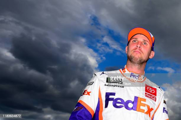 Denny Hamlin, driver of the FedEx Freight Toyota, stands on the grid during qualifying for the Monster Energy NASCAR Cup Series First Data 500 at...