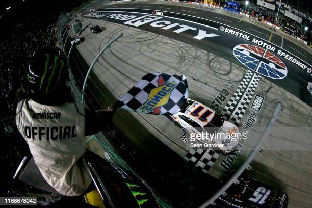 Denny Hamlin driver of the FedEx Freight Toyota takes the checkered flag to win the Monster Energy NASCAR Cup Series Bass Pro Shops NRA Night Race at...