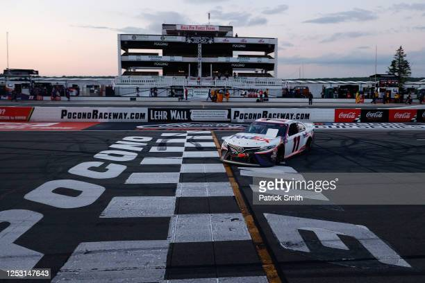 Denny Hamlin, driver of the FedEx Ground Toyota, celebrates after winning the NASCAR Cup Series Pocono 350 at Pocono Raceway on June 28, 2020 in Long...