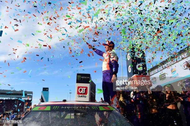Denny Hamlin, driver of the FedEx Ground Toyota, celebrates in Victory Lane after winning the Monster Energy NASCAR Cup Series Bluegreen Vacations...