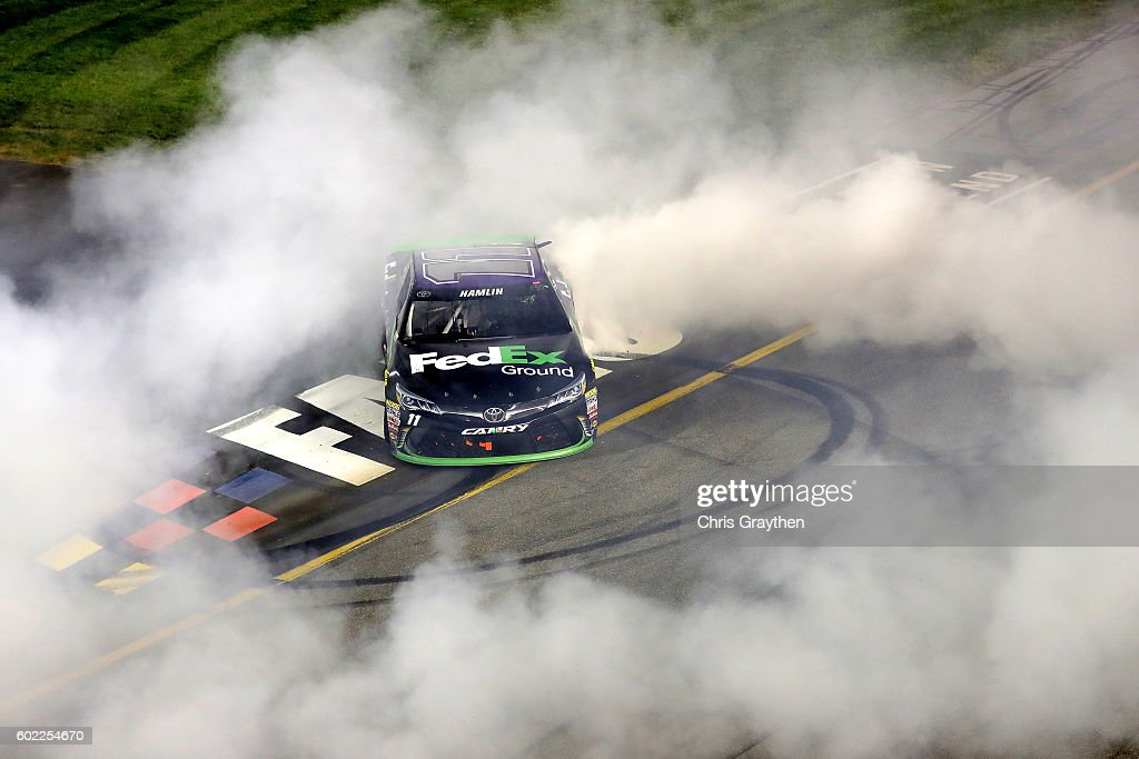 Denny Hamlin, driver of the #11 FedEx Ground Toyota, celebrates with a burnout after winning the NASCAR Sprint Cup Series Federated Auto Parts 400 at Richmond International Raceway on September 10, 2016 in Richmond, Virginia.