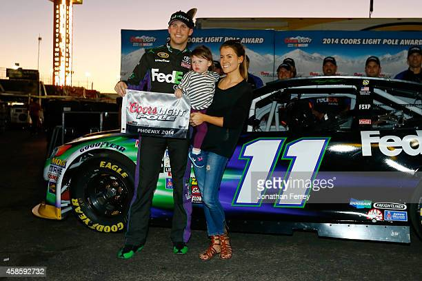 Denny Hamlin driver of the FedEx Ground Toyota his girlfriend Jordan Fish and his daughter Taylor James Hamlin pose with the Coors Light Pole Award...