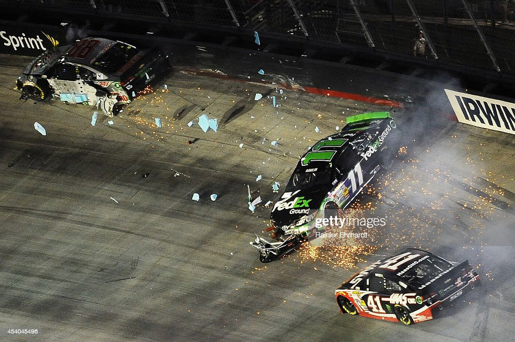 Denny Hamlin, driver of the #11 FedEx Ground Toyota, is involved in an incident during the NASCAR Sprint Cup Series Irwin Tools Night Race at Bristol Motor Speedway on August 23, 2014 in Bristol, Tennessee.