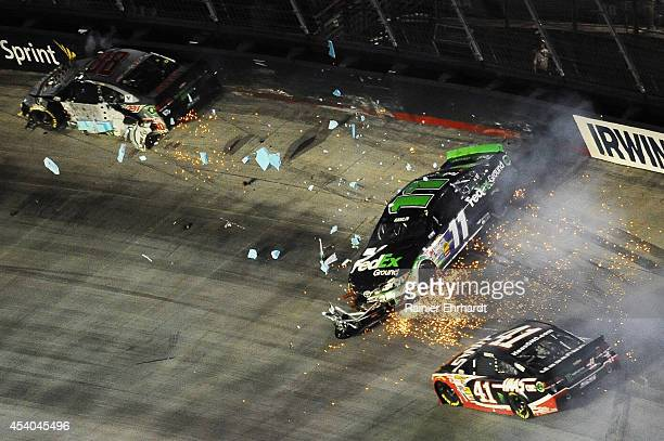 Denny Hamlin driver of the FedEx Ground Toyota is involved in an incident during the NASCAR Sprint Cup Series Irwin Tools Night Race at Bristol Motor...