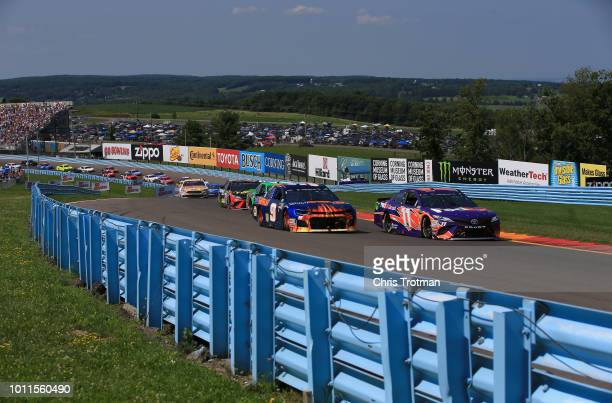 Denny Hamlin driver of the FedEx Ground Toyota lead the field during the Monster Energy NASCAR Cup Series GoBowling at The Glen at Watkins Glen...