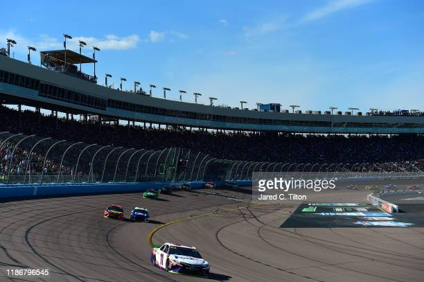 Denny Hamlin, driver of the FedEx Ground Toyota, leads a pack of cars during the Monster Energy NASCAR Cup Series Bluegreen Vacations 500 at ISM...