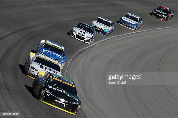 Denny Hamlin driver of the FedEx Ground Toyota leads a pack of cars during the NASCAR Sprint Cup Series myAFibRiskcom 400 at Chicagoland Speedway on...