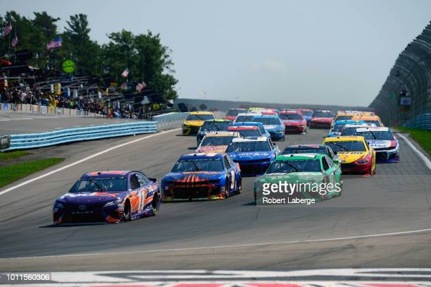 Denny Hamlin, driver of the FedEx Ground Toyota, leads Chase Elliott, driver of the SunEnergy1 Chevrolet, Kyle Busch, driver of the M&M's Crunchy...