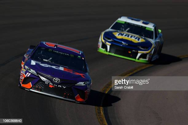 Denny Hamlin driver of the FedEx Ground Toyota leads Chase Elliott driver of the NAPA Auto Parts Chevrolet during the Monster Energy NASCAR Cup...