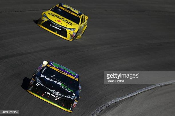Denny Hamlin driver of the FedEx Ground Toyota leads Matt Kenseth driver of the Dollar General Toyota during the NASCAR Sprint Cup Series...