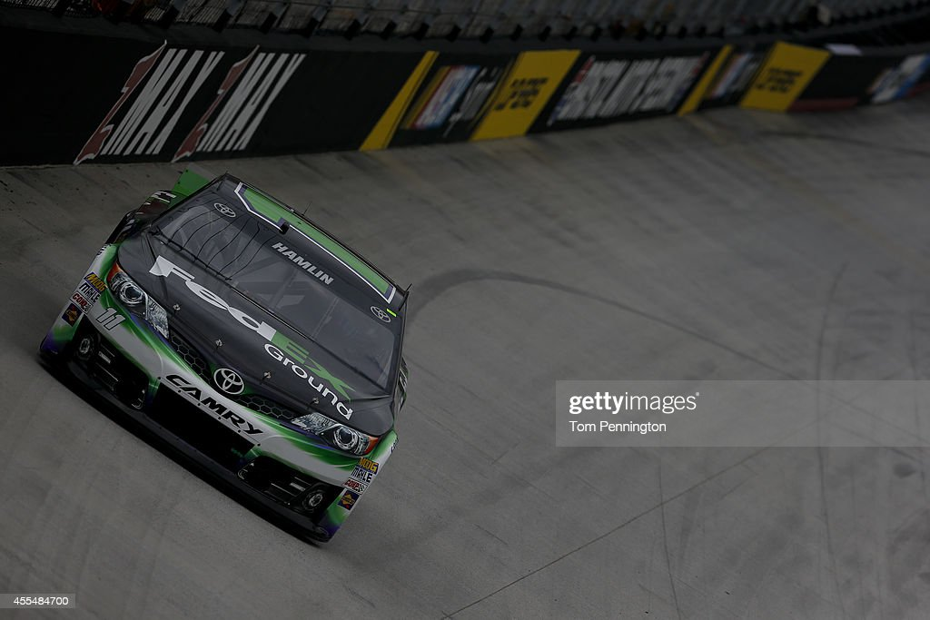 Denny Hamlin, driver of the #11 FedEx Ground Toyota, practices for the NASCAR Sprint Cup Series Irwin Tools Night Race at Bristol Motor Speedway on August 22, 2014 in Bristol, Tennessee.