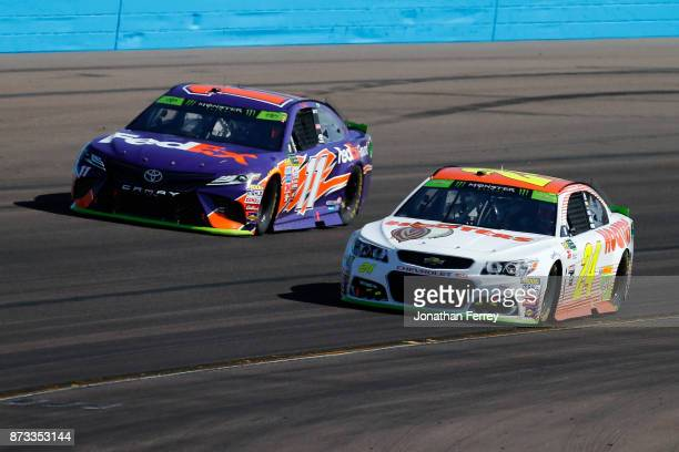 Denny Hamlin driver of the FedEx Ground Toyota races Chase Elliott driver of the Hooters Chevrolet during the Monster Energy NASCAR Cup Series CanAm...