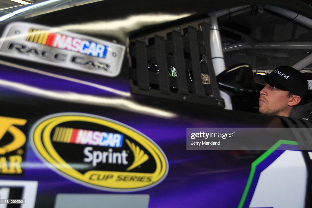 Denny Hamlin, driver of the #11 FedEx Ground Toyota, sits in his car during practice for the NASCAR Sprint Cup Series Bank of America 500 at Charlotte Motor Speedway on October 11, 2013 in Concord, North Carolina.