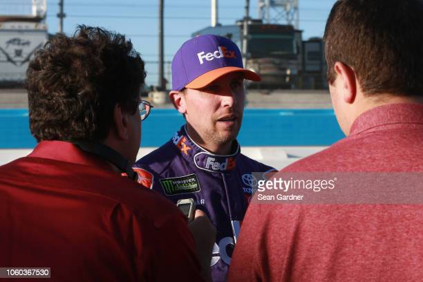 Denny Hamlin driver of the FedEx Ground Toyota speaks with the media following the Monster Energy NASCAR Cup Series CanAm 500 at ISM Raceway on...