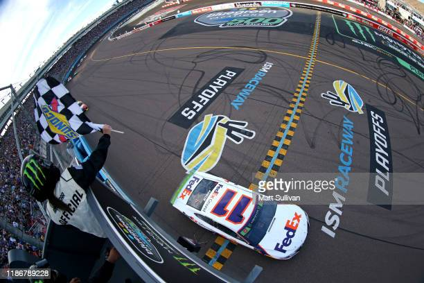 Denny Hamlin, driver of the FedEx Ground Toyota, takes the checkered flag to win the Monster Energy NASCAR Cup Series Bluegreen Vacations 500 at ISM...