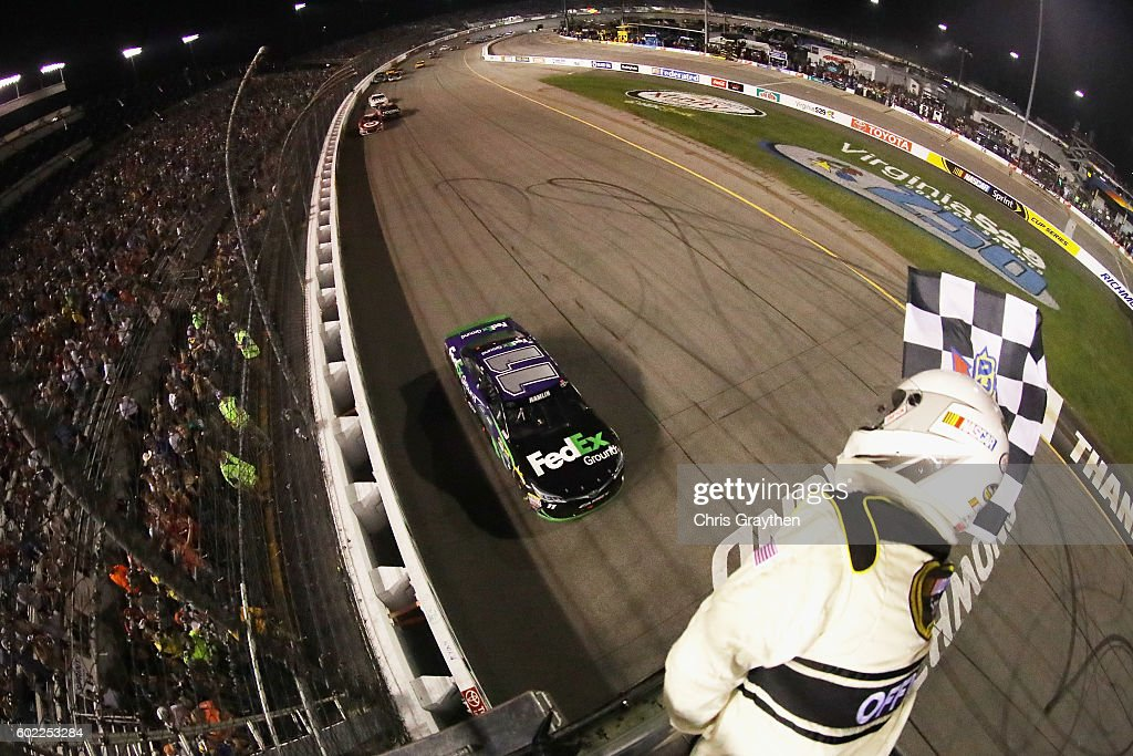 Denny Hamlin, driver of the #11 FedEx Ground Toyota, takes the checkered flag to win the NASCAR Sprint Cup Series Federated Auto Parts 400 at Richmond International Raceway on September 10, 2016 in Richmond, Virginia.