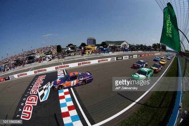 Denny Hamlin, driver of the FedEx Ground Toyota, takes the green flag to start the Monster Energy NASCAR Cup Series GoBowling at The Glen at Watkins...