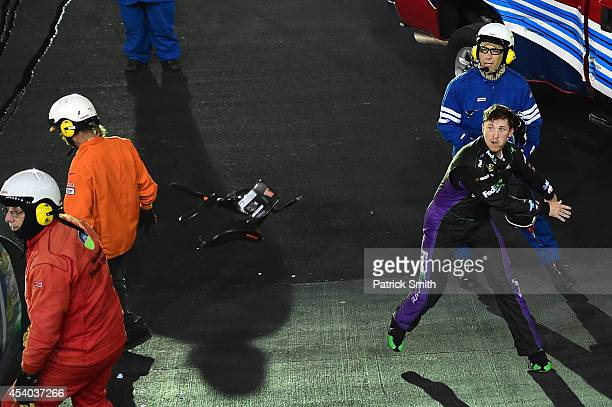 Denny Hamlin driver of the FedEx Ground Toyota throws his hans device at Kevin Harvick driver of the Jimmy John's Chevrolet after an ontrack incident...