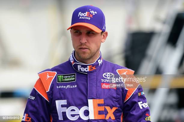 Denny Hamlin driver of the FedEx Ground Toyota walks through the garage area during practice for the Monster Energy NASCAR Cup Series Folds of Honor...