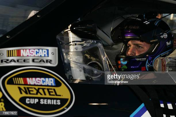 Denny Hamlin, driver of the FedEx Kinko's Chevrolet, sits in his car during qualifying for the NASCAR Nextel Cup Series Subway Fresh Fit 500 at...